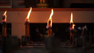 Candles burning in a temple. Abstract step, level and faith and belief in religion background