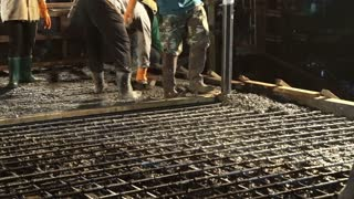 Cement concrete pour at night using pump