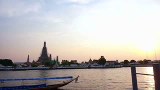 Chao Phraya river in Bangkok, Thailand. Boats traffic transportation in the evening with temple of dawn background