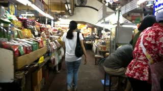 CHIANGMAI, THAILAND - April 2015: Fast forward girl walking though Warorot Market (Kad Luang). Food and fashion classic market for tourist and local people