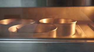 Chocolate cake baking process in the oven at bakery shop
