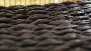 Close up of rattan texture horizontal tracking and bamboo curtain. Asian interior style
