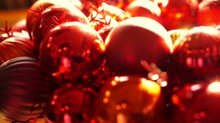 Close up, Shiny red and gold Christmas ball mistletoe ornaments in morning new year light