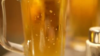 Close up shot of golden beer. Abstract drinking and party after long day of work