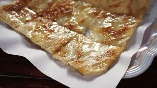 Close up shot of Thai popular street food, sweet crispy pancake roti serving in plate