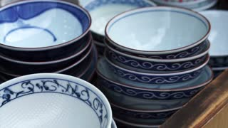 Closeup shot of Japanese style ceramic bowls selling Asia shop