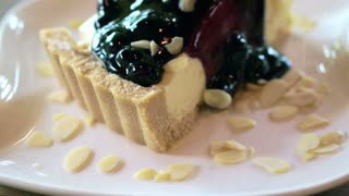delicious thick piece of blueberry cheesecake tart with almond dressing