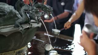 Dragon fountain in Japan. Providing water for hand and spirit wash before get in Japanese temple