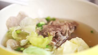 Eating Chinese food, wonton dumpling soup