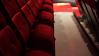 Empty red chair row in cinema theater