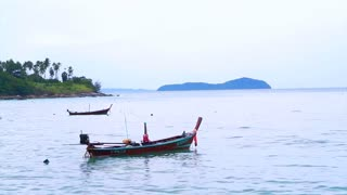 Fishing boat off the coast of phuket ocean thailand