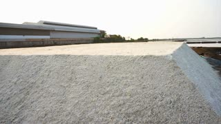 fleur de sel, flower of sea salt in salt pan farm, salt field with morning sun