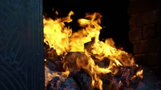 full HD of Chinese tradition, Burning silver and gold paper for ancestor in the temple. Flame moment on black background