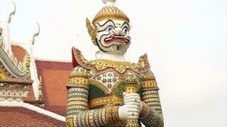 Giant statue around temple of dawn, wat Arun, landmark of Bangkok, Thailand