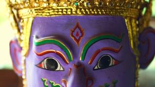 Golden Khon masks performance display in morning sun
