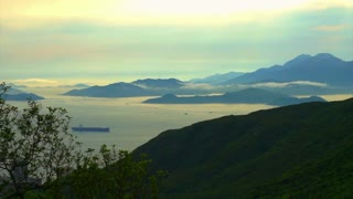 golden ocean bay with mountain silhouette landscape. beautiful panorama view of nature