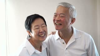 Happy Asian senior couple Laughing and talking on white background