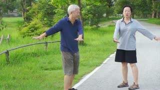 Happy Asian senior couple walking exercise along the lake. Abstract love health and nature