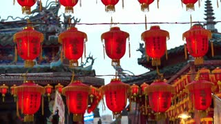 HD video  Chinese red lanterns. Illuminate lamps to celebrate Chinese New Year. Beautiful night scene of temple in Taiwan China