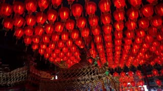 HD video of Thousand of Chinese red lanterns. Illuminate lamps to celebrate Chinese New Year. Beautiful night scene of temple in Taiwan
