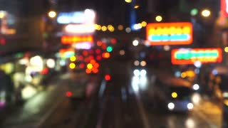 Hong Kong night street blurred video of city signs and transportations