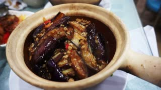 Hong Kong style clay pot rice bowl with eggplants and pork