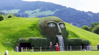 INNSBRUCK, AUSTRIA - JULY 2014: people walking at Swarovski Crystal Worlds, Swarovski Kristallwelten park