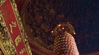 Interior of Taiwanese, Chinese temple with small god figures light lit for good luck and pray