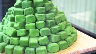 Japanese dessert , pile of green tea powdered sweets candy