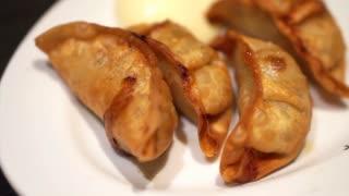 Japanese dumpling, Deep fried Gyoza eating with mayonnaise with chopsticks