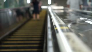 Japanese escalator manner to stand on one side for rush people to walk fast