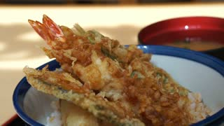 Japanese food, Fried seafood tempura shrimp, fish, squid and vegetables over rice bowl