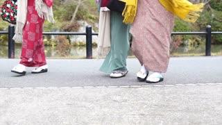 Japanese girls wear kimono parasol and geta Japan sandal footwear