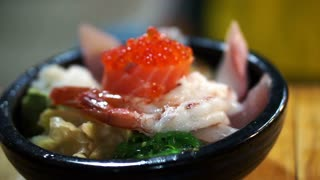 Japanese gourmet sashimi over rice bowl. Chirashi Assorted seafood