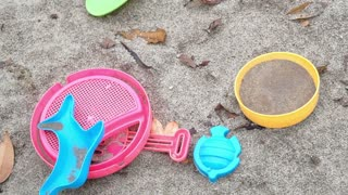 Kids, children playground sand pit and toys inside