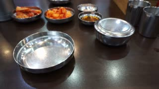 Korean restaurant set up with stainless steel ware as popular traditional culture for cuisine