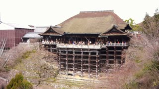 KYOTO, JAPAN - MARCH 2015: tourists visit Kiyomizu dera temple. Japanese world heritage landmark