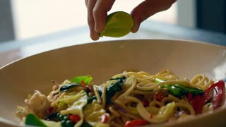 lime squeeze on Thai food, drunken seafood spaghetti