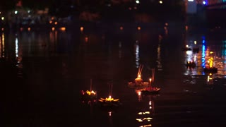 Loi Krathong festival in Chiangmai Thailand, floating basket of flowers on river during celebrated on Thai  full moon lunar calendar