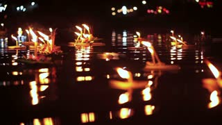 Loi Krathong Festival in Chiangmai, Thailand. Thousand of floating decorated baskets and candles to pay respect to river goddess. Thai traditional culture on full moon night