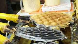 Making of Hong Kong old style honey comb waffle. Freshly make at the shop with steel mole