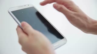 Man using mobile phone with touch screen