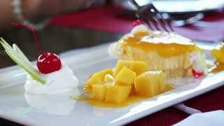 Mango Cheese Cake on white plate