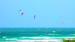 Many glide surf, kite board sport playing in the ocean