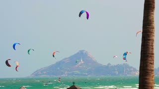 Many glide surfing, kite board surfing sport playing in the ocean