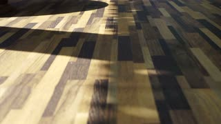 Morning sun shining on Beautiful wood texture vinyl floor, interior material