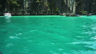 Mountain of tropical islands of Phuket, Krabi in Thailand. Boat trip in the middle of crystal green ocean lagoon