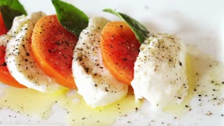 mozzarella cheese with tomatoes olive oil and basil leaves