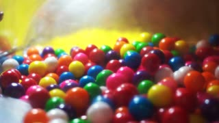 Multicolour pile of candy sweets food background, closeup view
