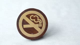 No Smoking Symbol paint on wooden sign with copy space